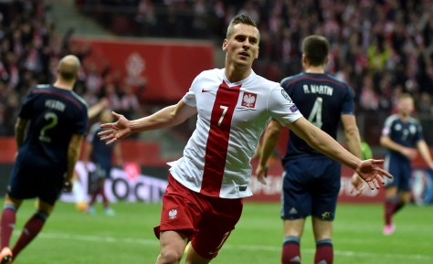 epa04446898 Arkadiusz Milik of Poland celebrates after scoring the 2-2 goal during the UEFA EURO 2016 Group D qualifying match between Poland and Scotland at the National Stadium in Warsaw, Poland, 14 October 2014. EPA/BARTLOMIEJ ZBOROWSKI POLAND OUT