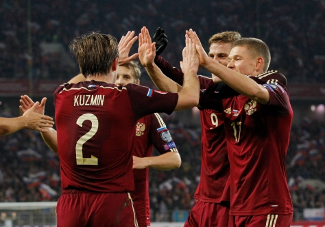Russia's team players celebrate their goal during a Euro 2016 Group G qualifying soccer match between Russia and Montenegro in the Otkrytie Arena stadium in Moscow, Russia, Monday, Oct. 12, 2015. (AP Photo/Alexander Zemlianichenko)