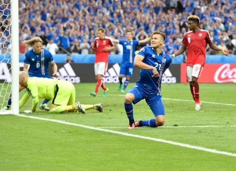Iceland's Arnor Ingvi Traustason celebrates scoring his team's second goal during the Euro 2016 Group F soccer match between Iceland and Austria at the Stade de France in Saint-Denis, north of Paris, France, Wednesday, June 22, 2016. (AP Photo/Martin Meissner)